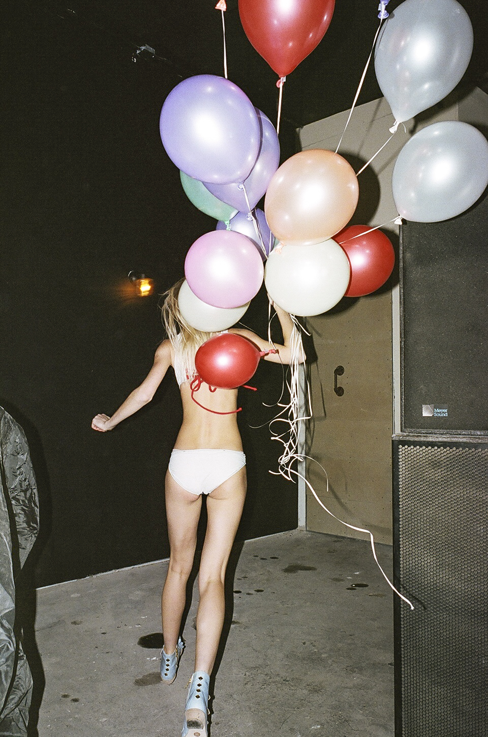 blonde-with-ballons-running